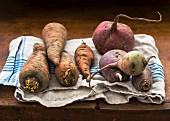 Carrots and turnips on a tea towel