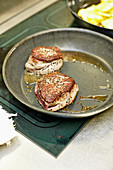 Beef fillet steaks in a pan