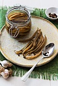 Pickled green beans with garlic and pepper