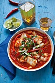 Moqueca (fish stew, Brazil) with tomatoes, pepper and chillis