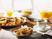 Breakfast with pancakes, fruit, coffee and orange juice