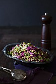 A red cabbage salad with Brussels sprouts and peas