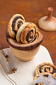 Poppyseed whirls in a wooden cup