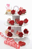 Cupcakes and red roses on a cake stand for Valentine's Day