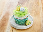 A vanilla cupcake with Easter decorations