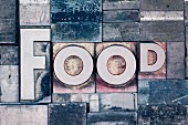 The word 'food' made up of metal letters