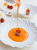 Salmorejo (cold tomato soup) with cherry tomatoes and tuna tartar