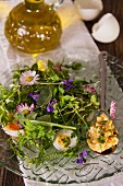 A wild herb salad with daisies and egg