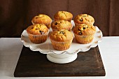 Muffins with chocolate chips on a cake stand