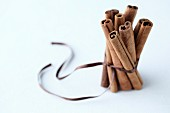 A bunch of cinnamon stick tied with a brown ribbon