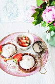 Strawberry tartlets topped with meringue and icing sugar
