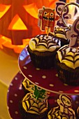 Spooky Halloween cupcakes decorated spider webs on a cake stand