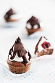 Black Forest Gateau Kisses (chocolate muffins with cherries, a whipped egg white topping and chocolate glaze)