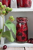 Jars of raspberry and cranberry jam