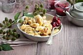 Kaiserschmarrn (shredded sugared pancake from Austria) with raspberry and cranberry jam