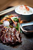 Grilled teriyaki rib-eye steak with udon noodles and dashi (Japan)
