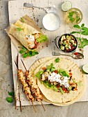 Chicken wraps with avocado salsa and sour cream