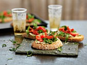 Bruschetta with tomato, rocket and white beans