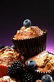 Carrot muffins with blackberries and blueberries for Halloween