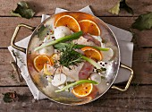 Chicken legs with onions, oranges and herbs