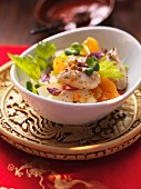 Guinea fowl breast with a celery and mandarin salad and pomegranate seeds (Asia)