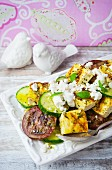 Tomato and cucumber salad with grilled tofu and feta cheese
