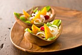 Golden beet salad in wooden bowls