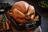 Roast turkey in a roasting tin