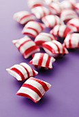 Red-and-white striped peppermint bonbons (close-up)