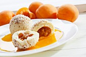 Apricot dumplings with ground hazelnuts