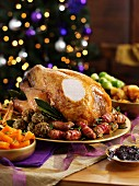 Sliced roast turkey with all the trimmings on a festive table