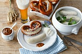 Bavarian supper with white sausage, lye pretzels, mustard and wheat beer