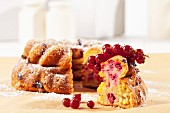 A redcurrant and quark cake dusted with icing sugar