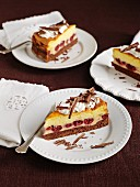 Three slices of Eierschecke (speciality layer cake from Saxony and Thuringia) with cherries