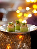 Cucumber rolls filled with prawns for Christmas