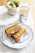 Two slices of carrot cake with nuts