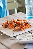 Fish and prawn skewers with herb yogurt