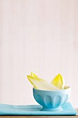 Chicory leaves in a light blue bowl