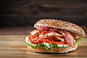 A bacon, lettuce and tomato bagel with mayonnaise