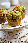 Pistachio muffins on an old cake stand