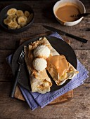 Pancakes with banana, vanilla ice cream and caramel sauce