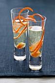 Champagne cocktails with orange zest