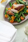Stuffed turkey breast on a bed of green vegetables