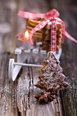Gingerbread with a miniature sledge, cinnamon stars and a candle