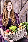 A girl holding a basket of fresh vegetables