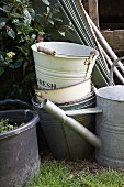 Various buckets and watering cans in garden