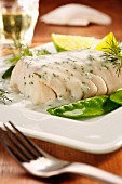 Fish fillet with a dill sauce and mange tout