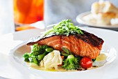 Grilled salmon teriyaki on a bed of vegetables