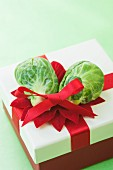 Brussels sprouts used to decorate a Christmas present