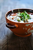 Lentil soup with carrots, feta cheese and cress